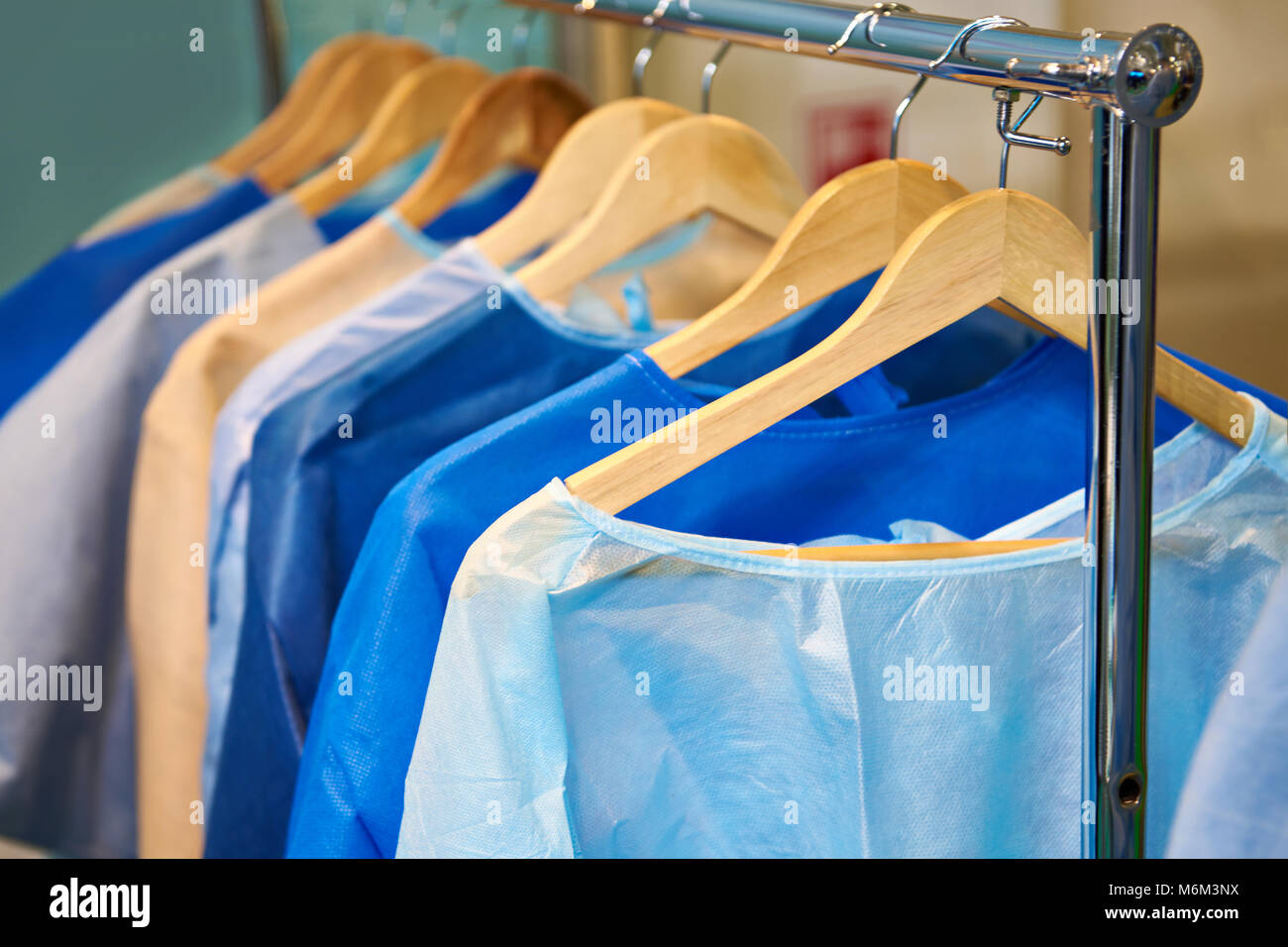 One-time medical surgical gowns on hangers Stock Photo: 176233622 ...