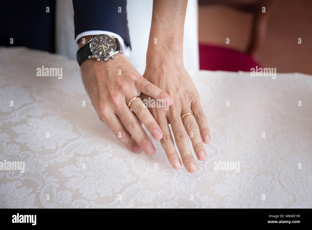 Hands Detail With Wedding Rings Exchange During A Wedding Stock