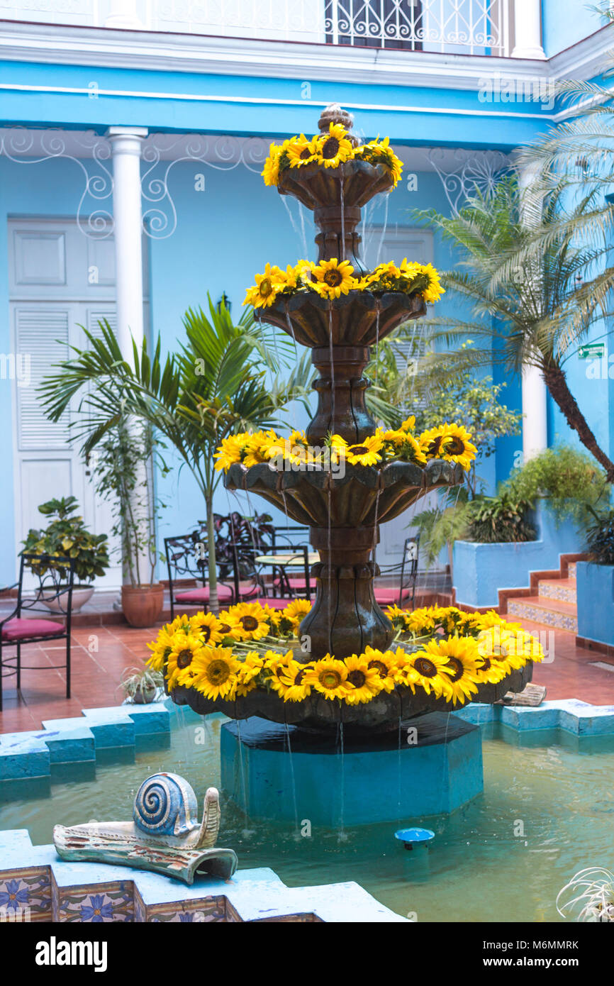 Fountain In Blue Inner Courtyard Of Union Hotel Decorated With Sunflowers