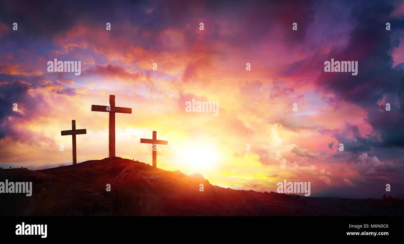 crucifixion of jesus christ at sunrise three crosses on hill stock