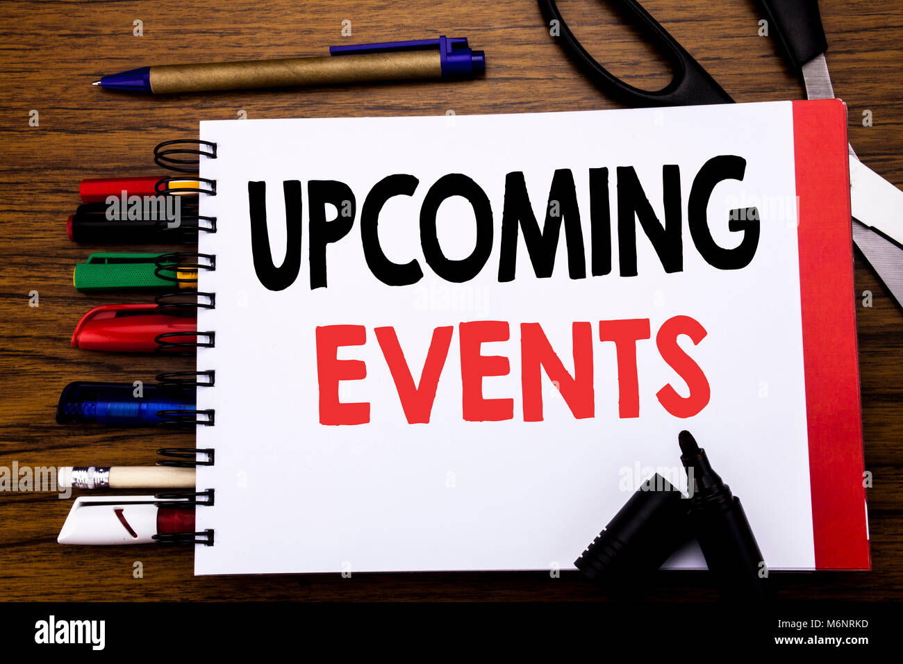 handwritten text showing upcoming events business concept for stock