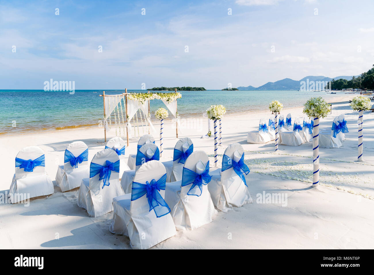 The Decoration Of Beach Wedding Venue In White And Blue Theme The