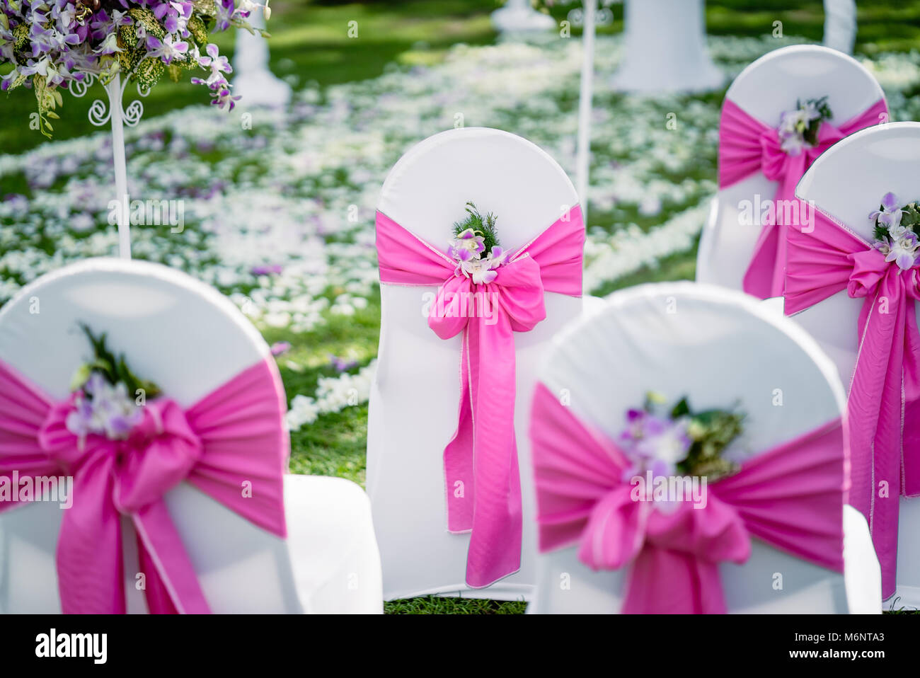 The wedding venue, The chairs with white lawn cover decorated in ...