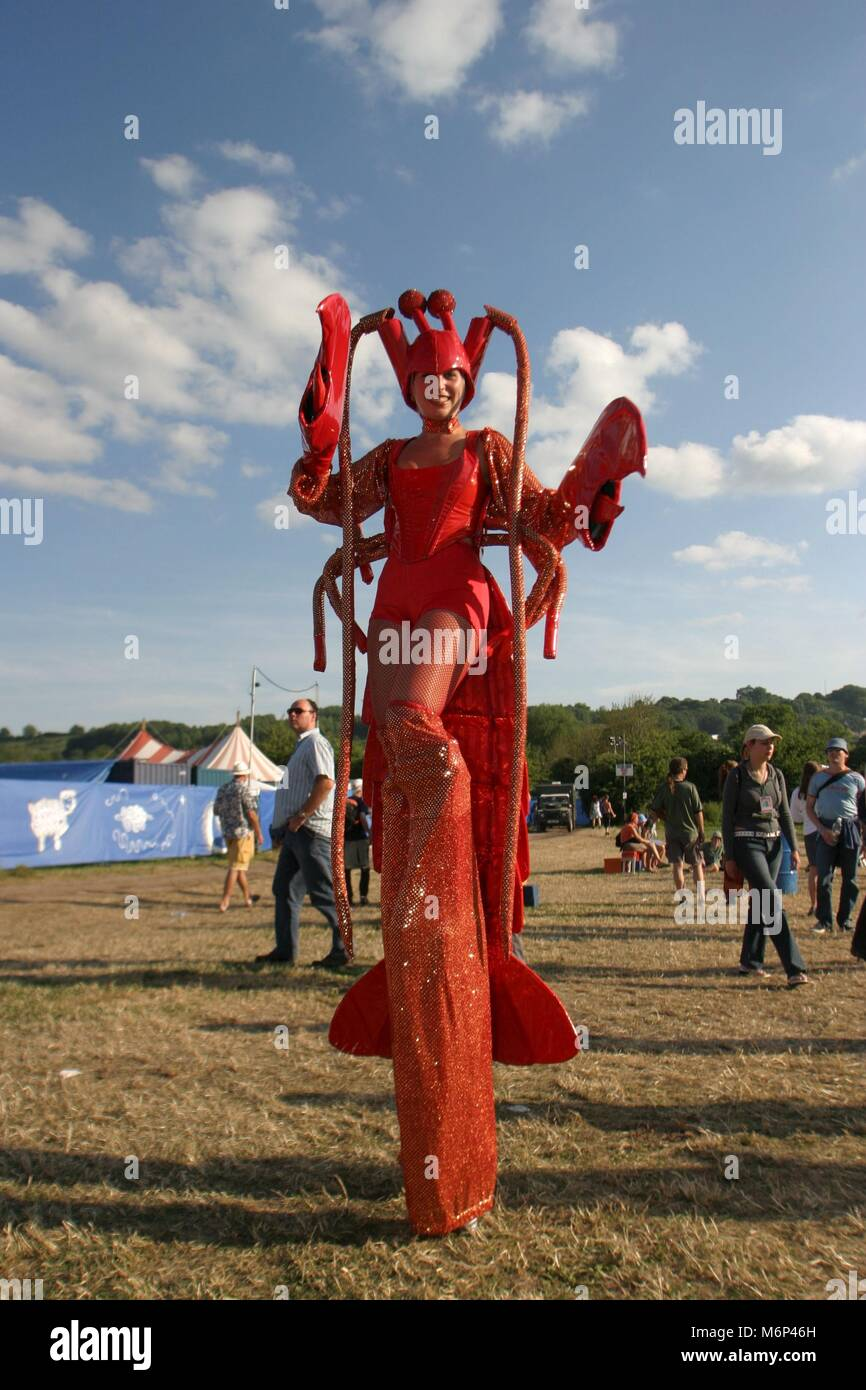 woman wearing a lobster outfit glastonbury festival somerset stock