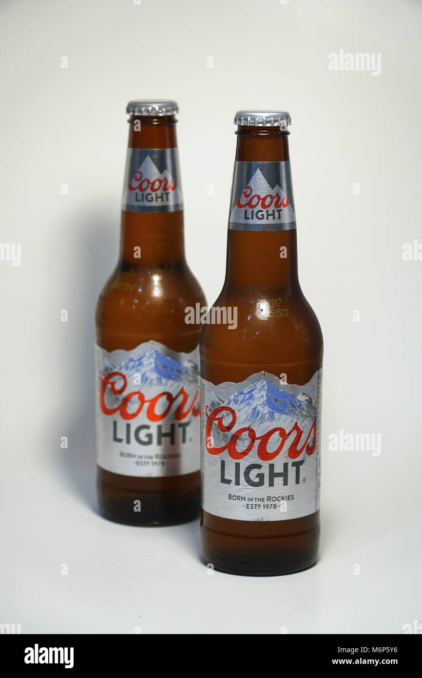 Coors Light Beer Bottle Against White Background. Product Shot. Silver  Bullet Alcoholic Drink Branded Cold As Rocky Mountains In Colorado. Brewed  In U Great Pictures