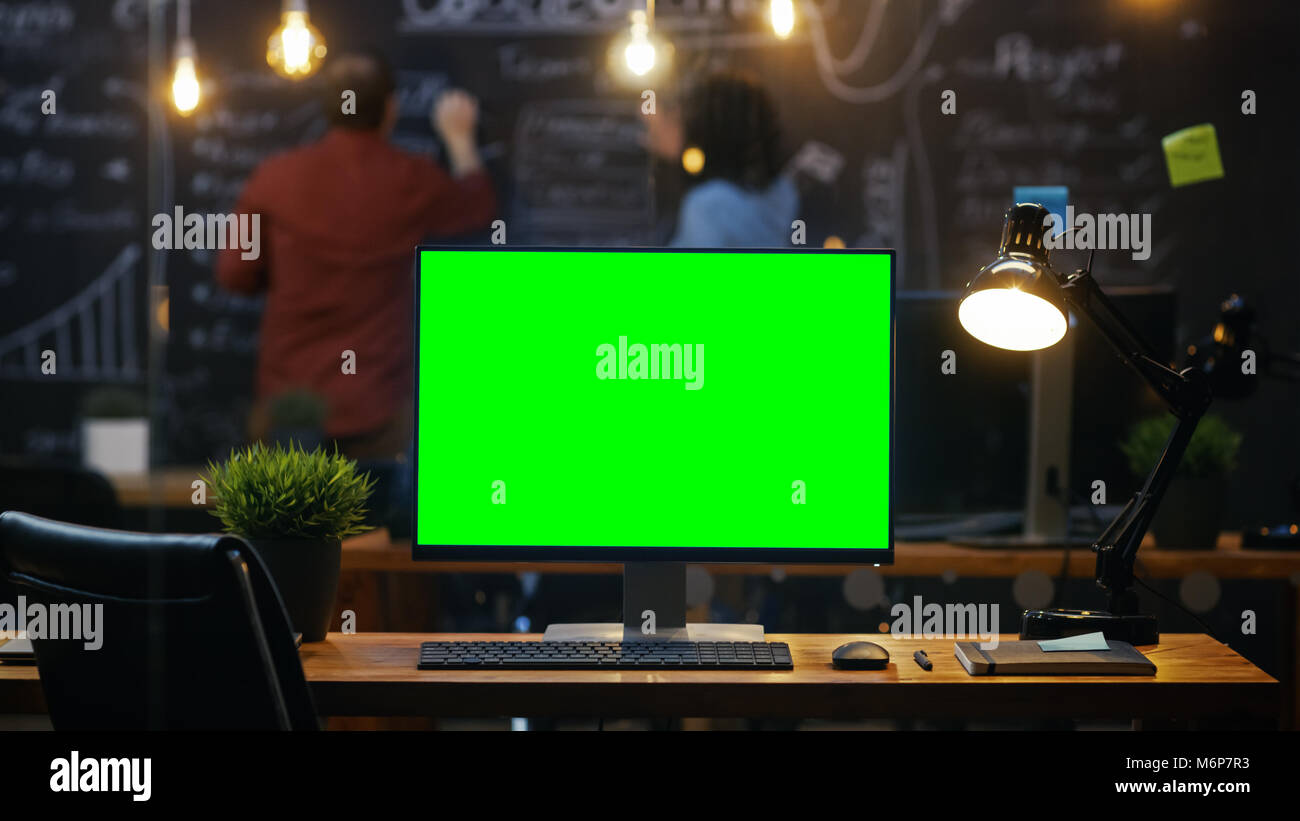 Personal Computer With Mock Up Green Screen Monitor Stands On The