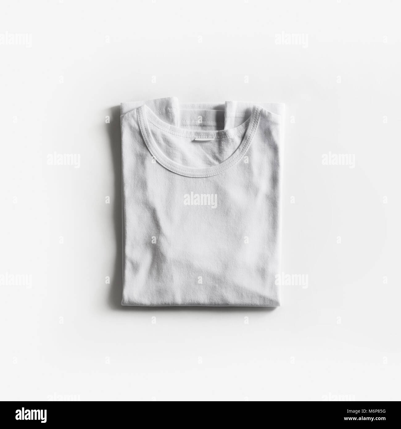 Tshirt Template For Your Design Folded Blank White T Shirt On Paper Background Flat Lay