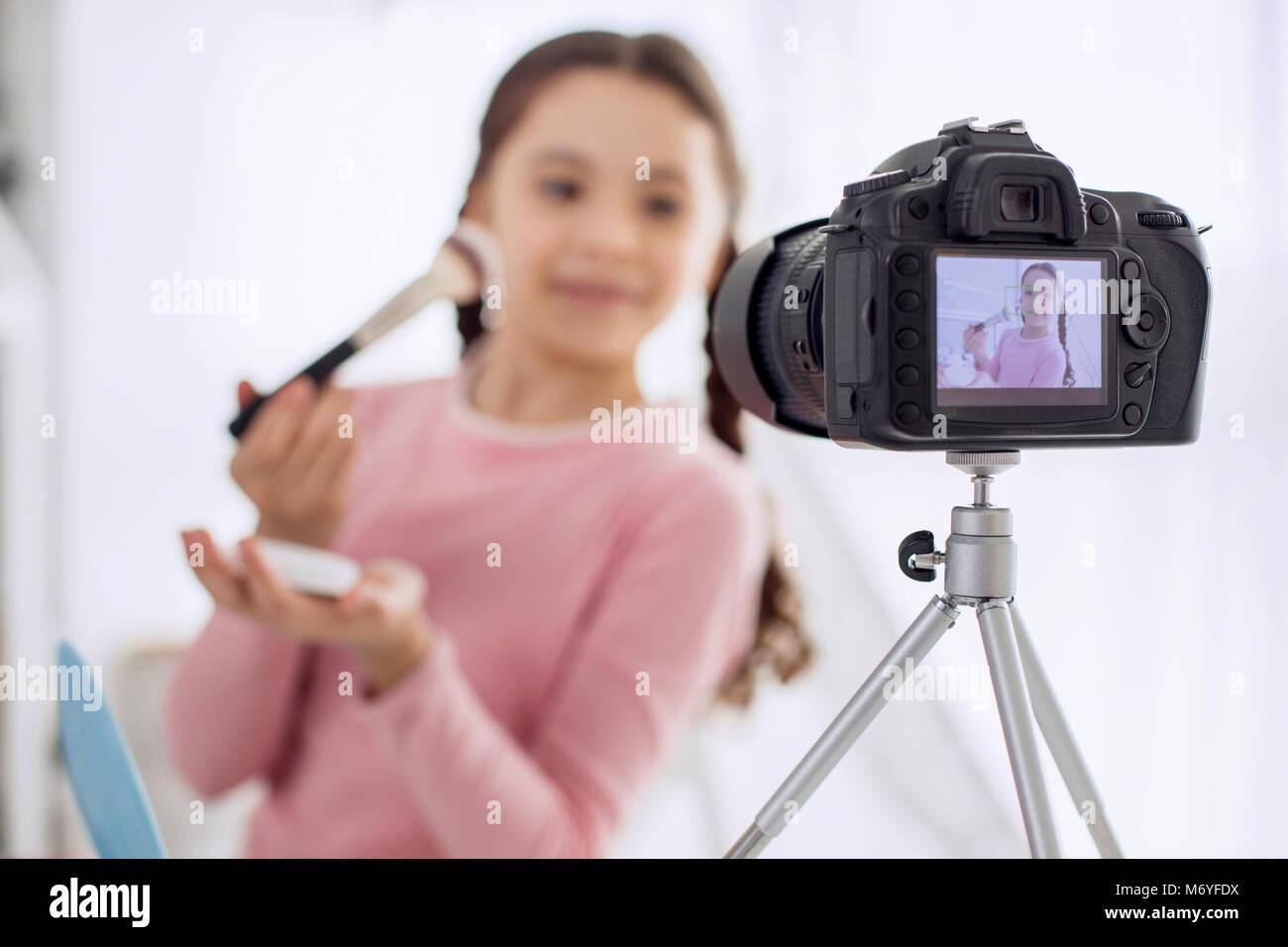 Makeup tutorial stock photos makeup tutorial stock images alamy professional camera filming girl making makeup tutorial stock image baditri Images