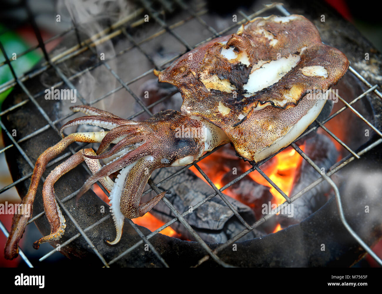 Charcoal grill restaurant stock photos charcoal grill for Fish on fire menu