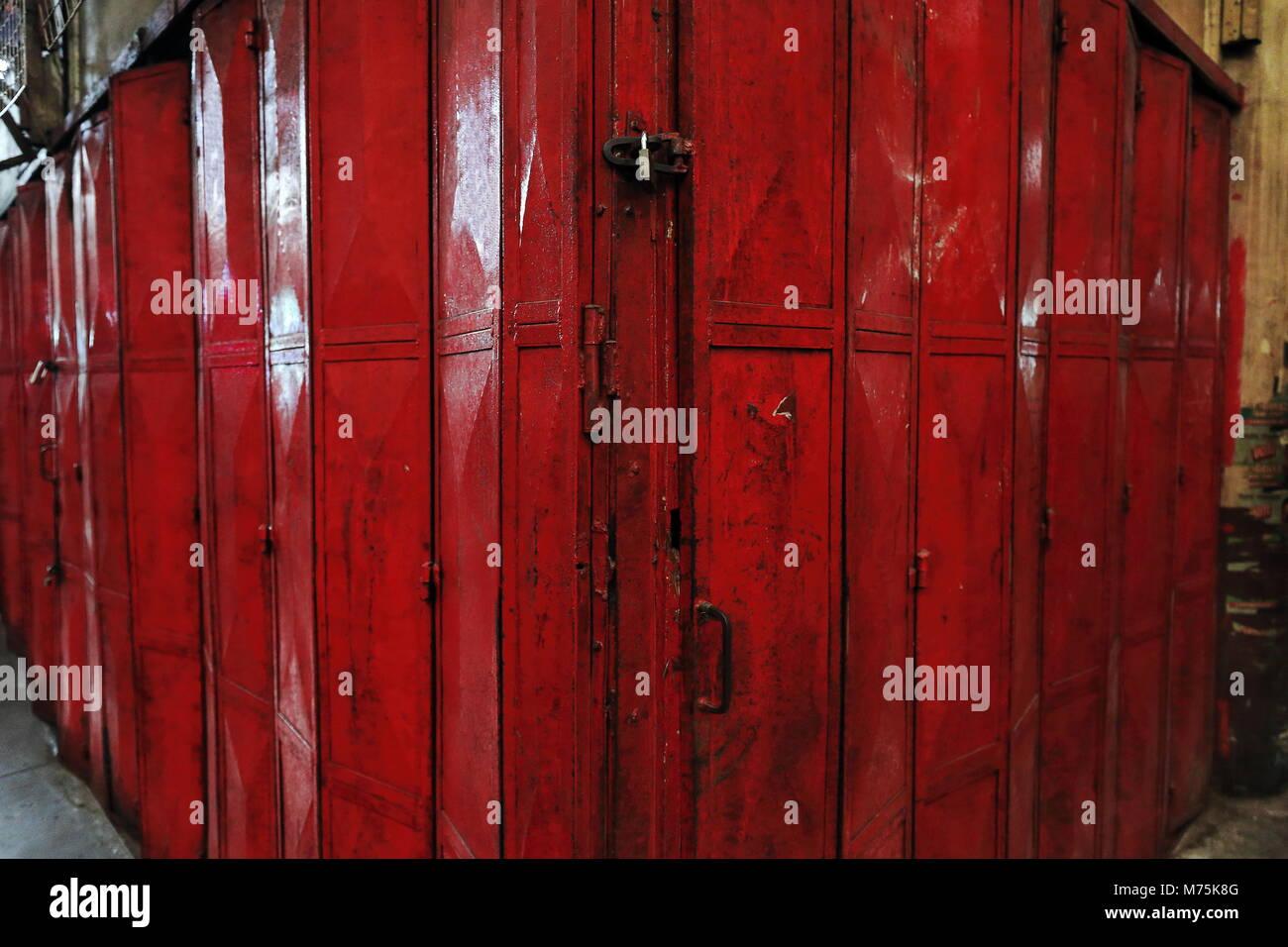 Orange Red Painted Padlock Closed Iron Hinged Folding Door Of A