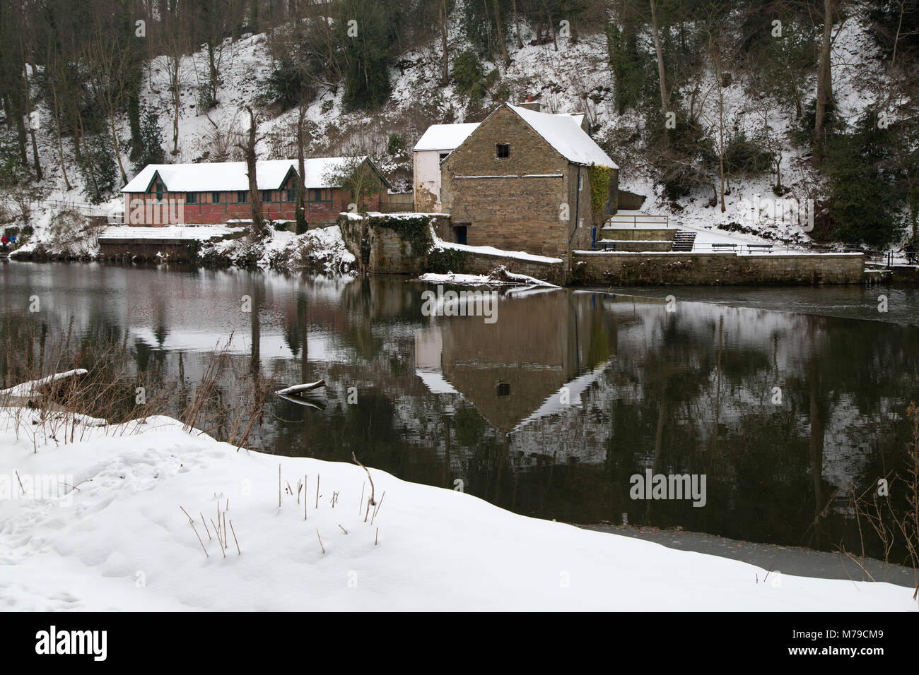 Snow Lies Around The Boathouse In Durham City England The Building