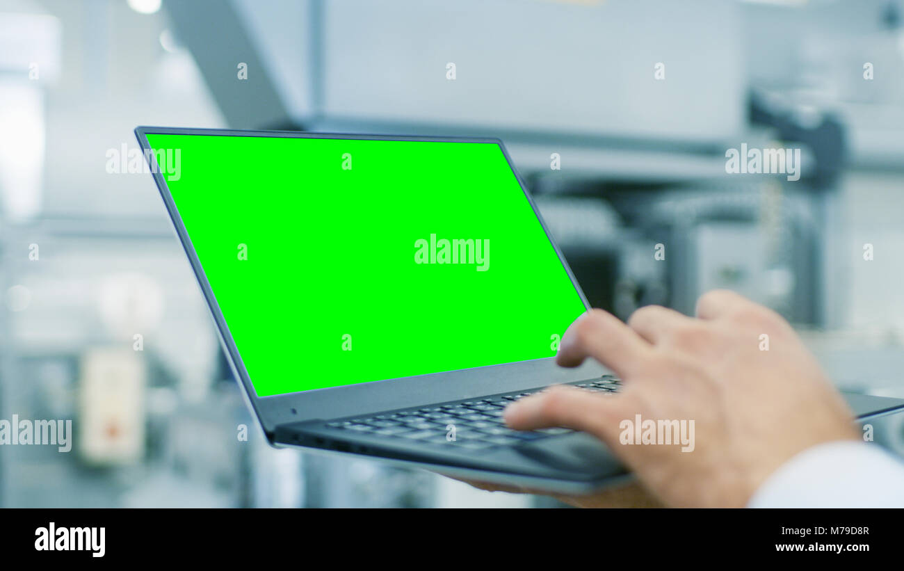 close up of the engineer holding laptop with green screen chroma key