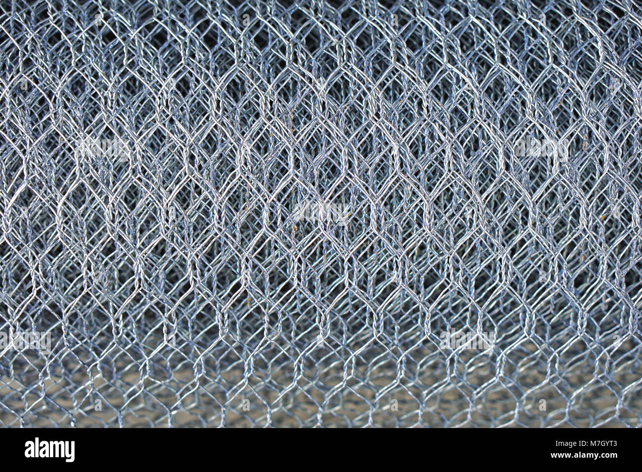 Steel metal mesh chicken wire roll Stock Photo: 176779347 - Alamy