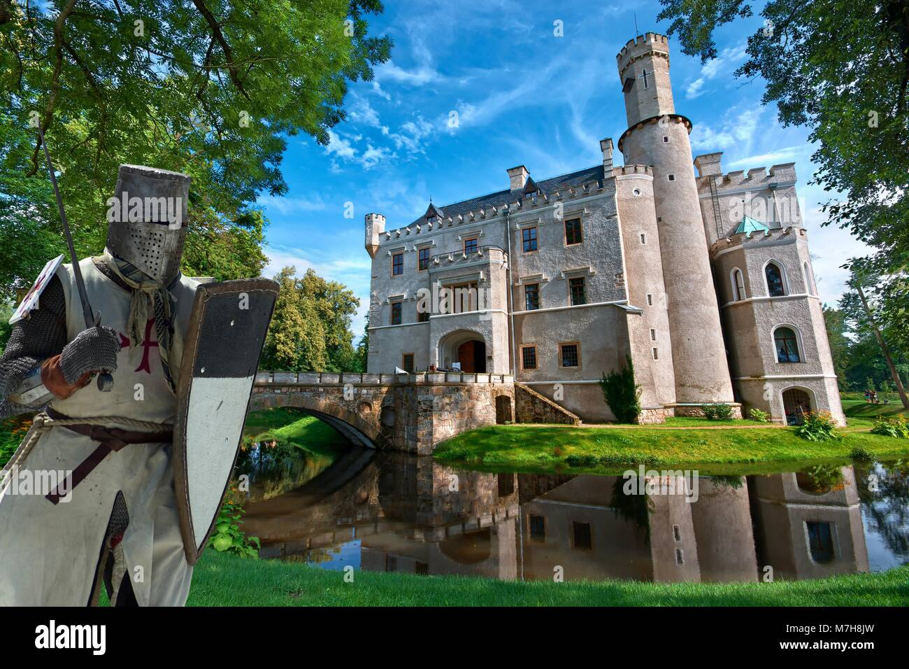 Templar Knight With Neo Gothic Style Castle Surrounded By A Moat In