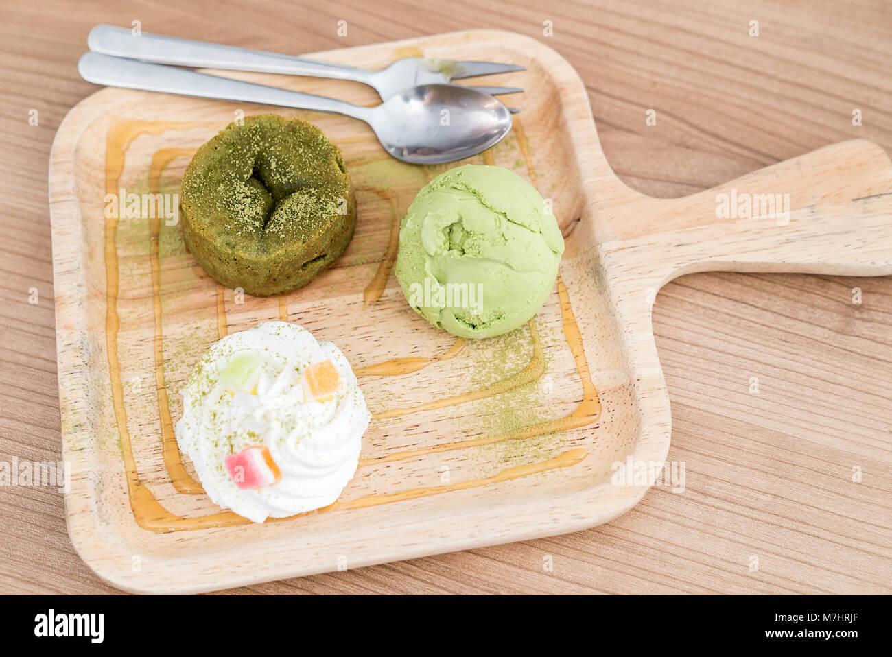 green tea lava cake with ice cream and green tea sauce stock photo