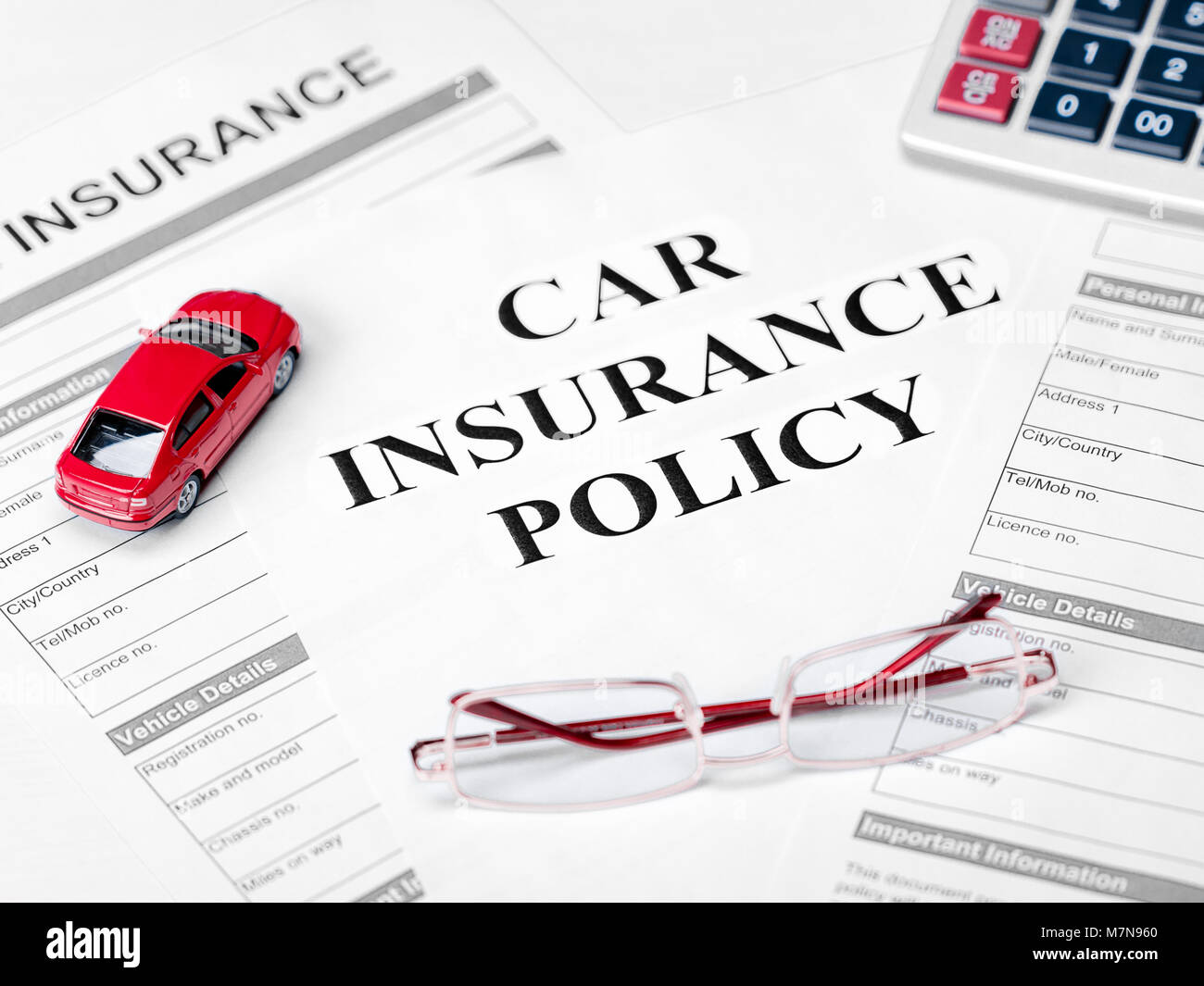 Car Insurance Policy Document Car Glasses And Calculator On Table