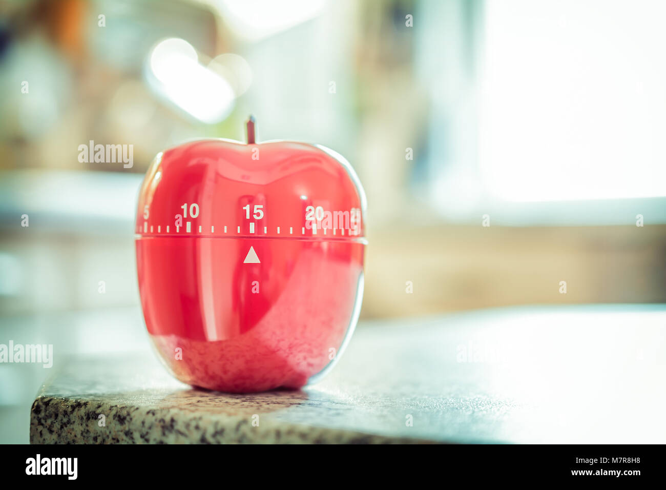 15 minutes red kitchen egg timer in apple shape stock photo