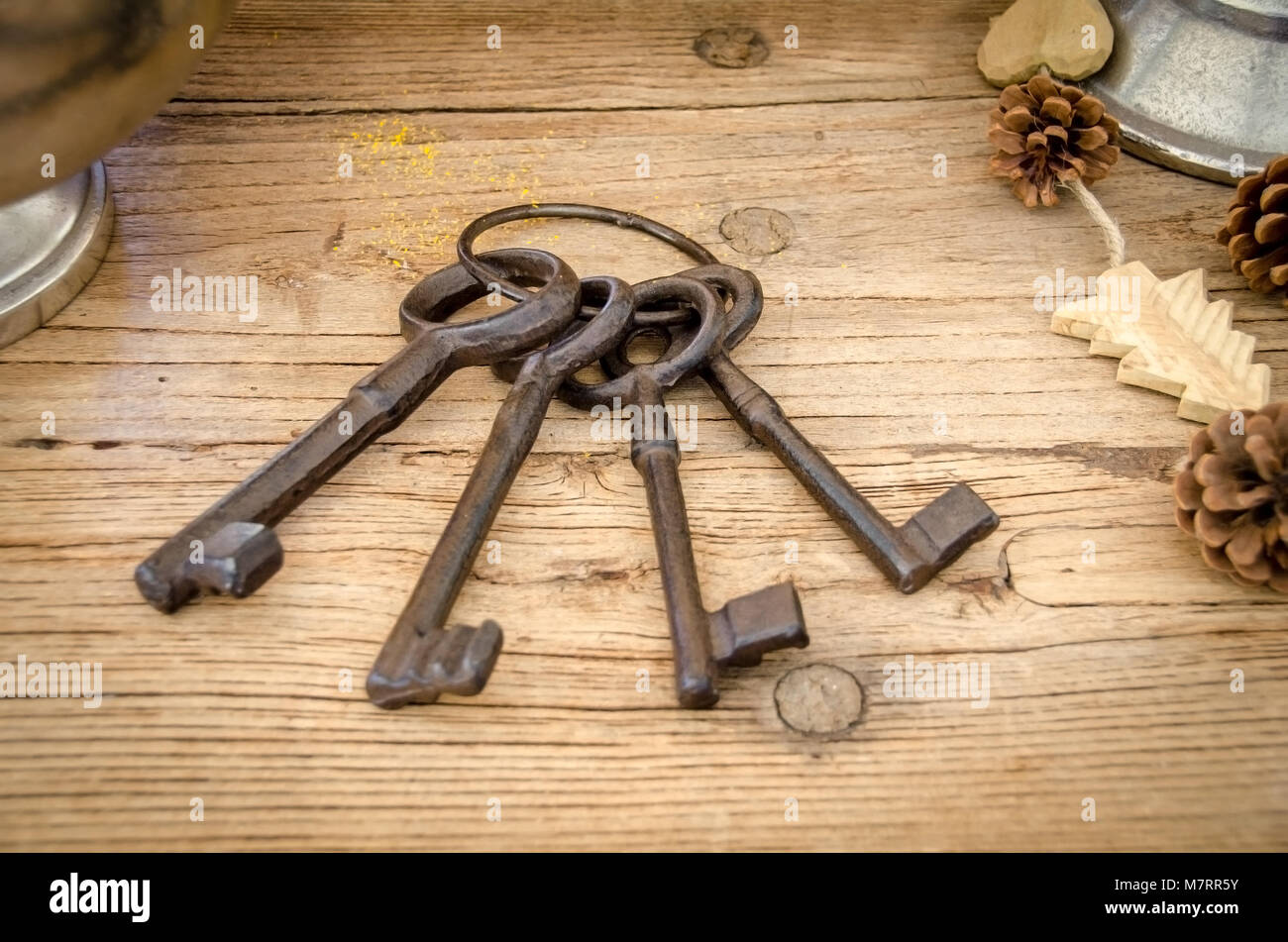 Rusty antique keys on wooden table as background Stock Photo ...