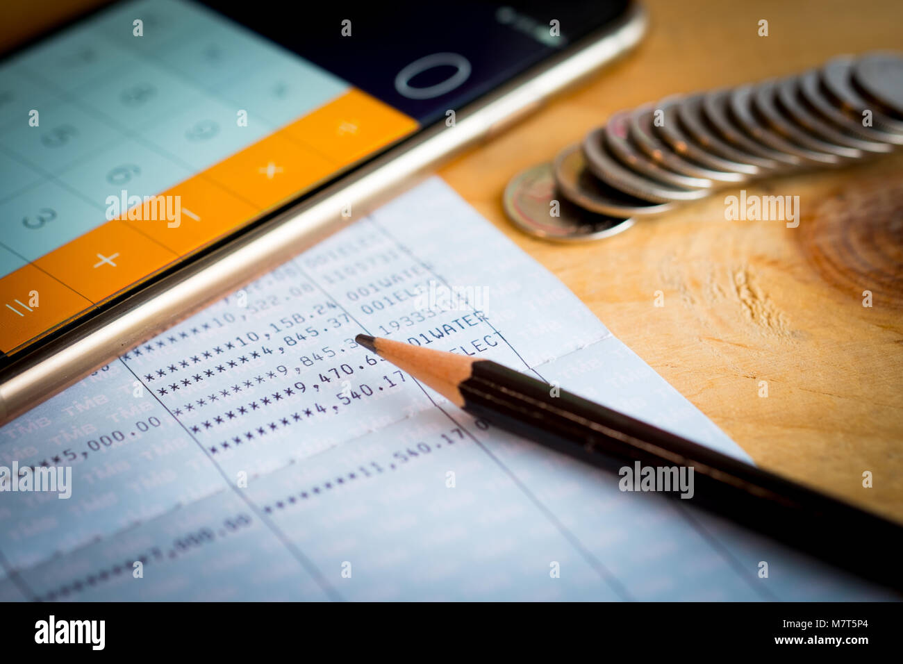 Savings Account Bank Book, Pencil And Smartphone Used As Calculator On  Wooden Table