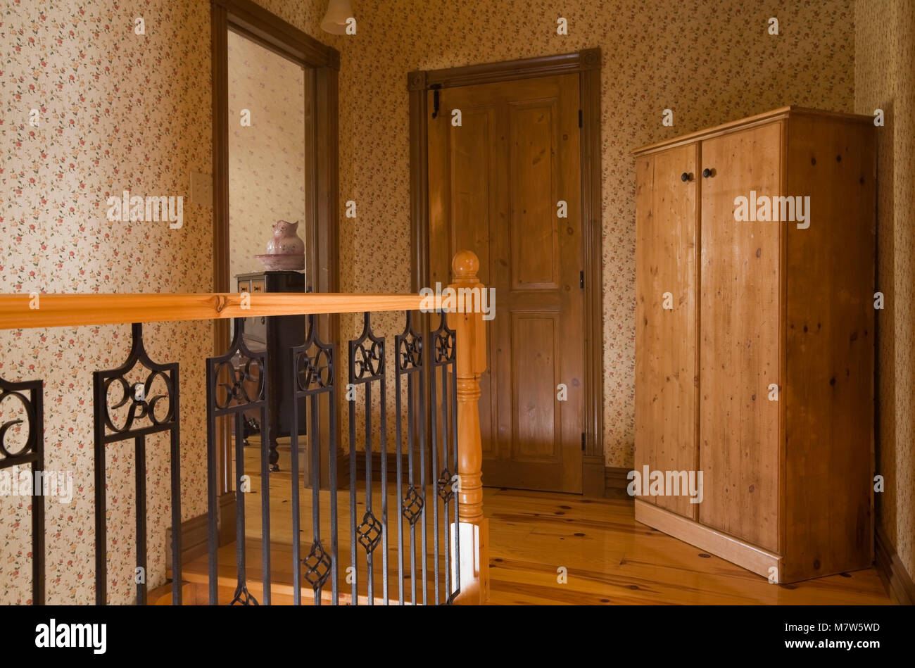 Railing And Armoire On The Upstairs Floor Of A Canadiana Cottage Style  Fieldstone Residential Home Built To Look Old In 2002, Lanaudiere, Quebec,  Cana