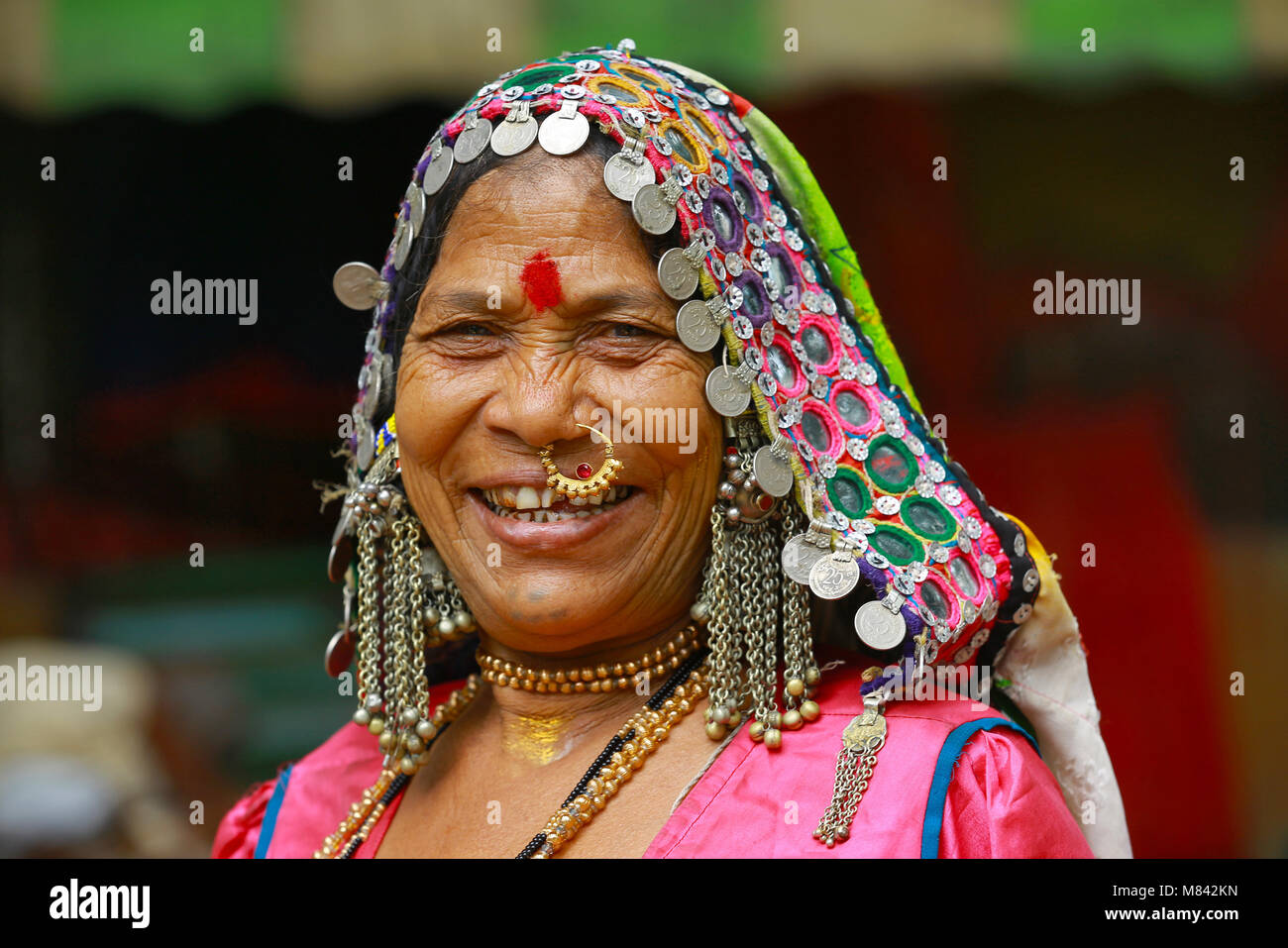 Close-up of women in traditional dress with earrings and nose ...