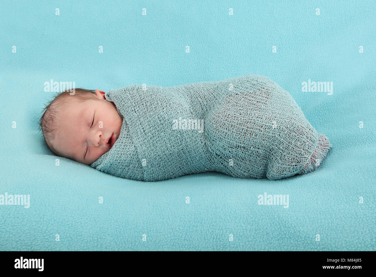 Newborn Baby Boy Happy And Confutable Swaddled In Soft Blanket In