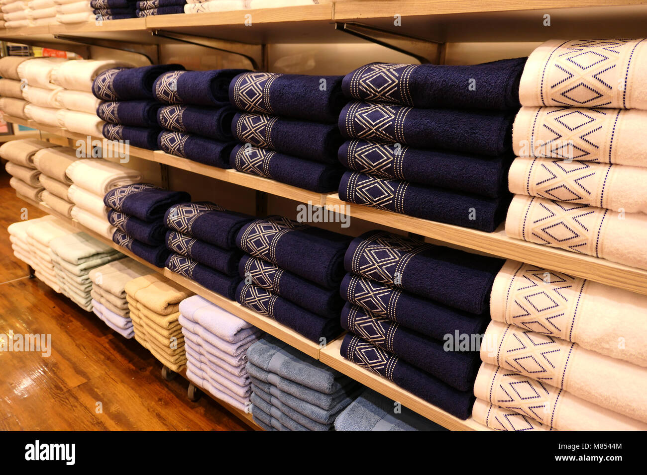 Piles of towels on the shelves Stock Photo: 177133956 - Alamy