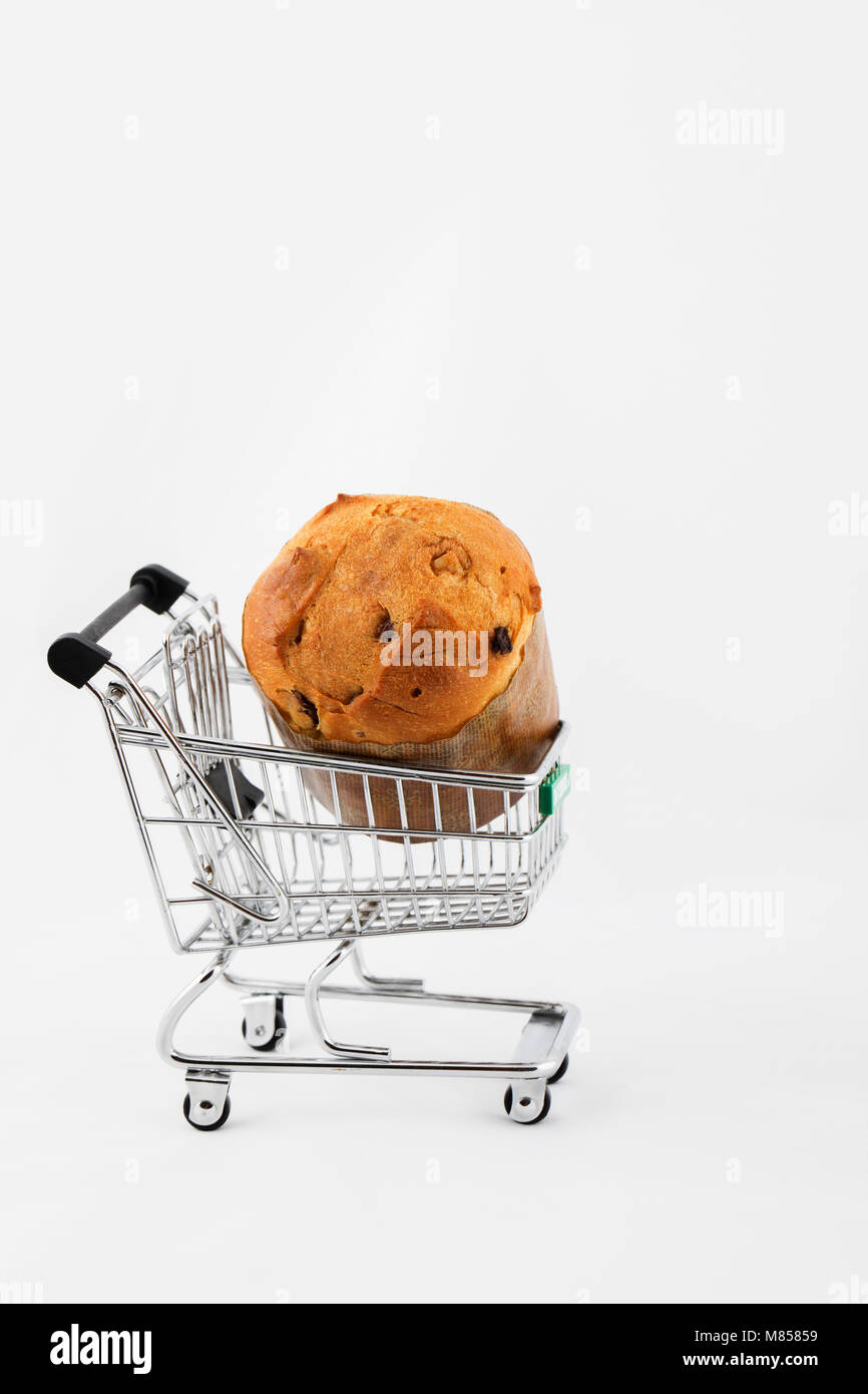 Traditional Italian Christmas sweet cake in a mini shopping cart on ...