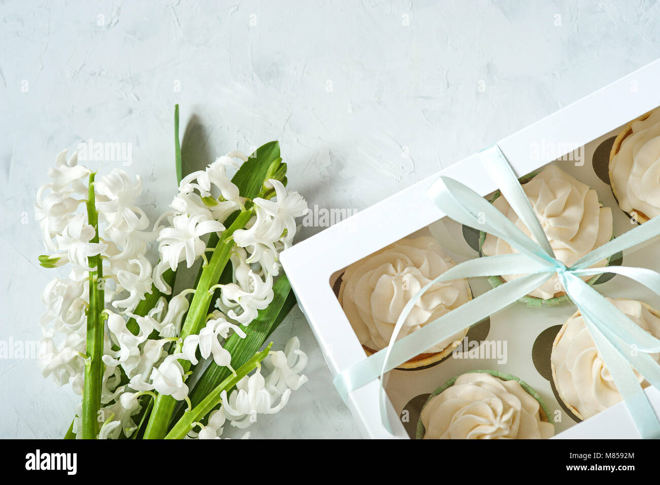Gift Box And White Flowers On Rustic Table For March 8
