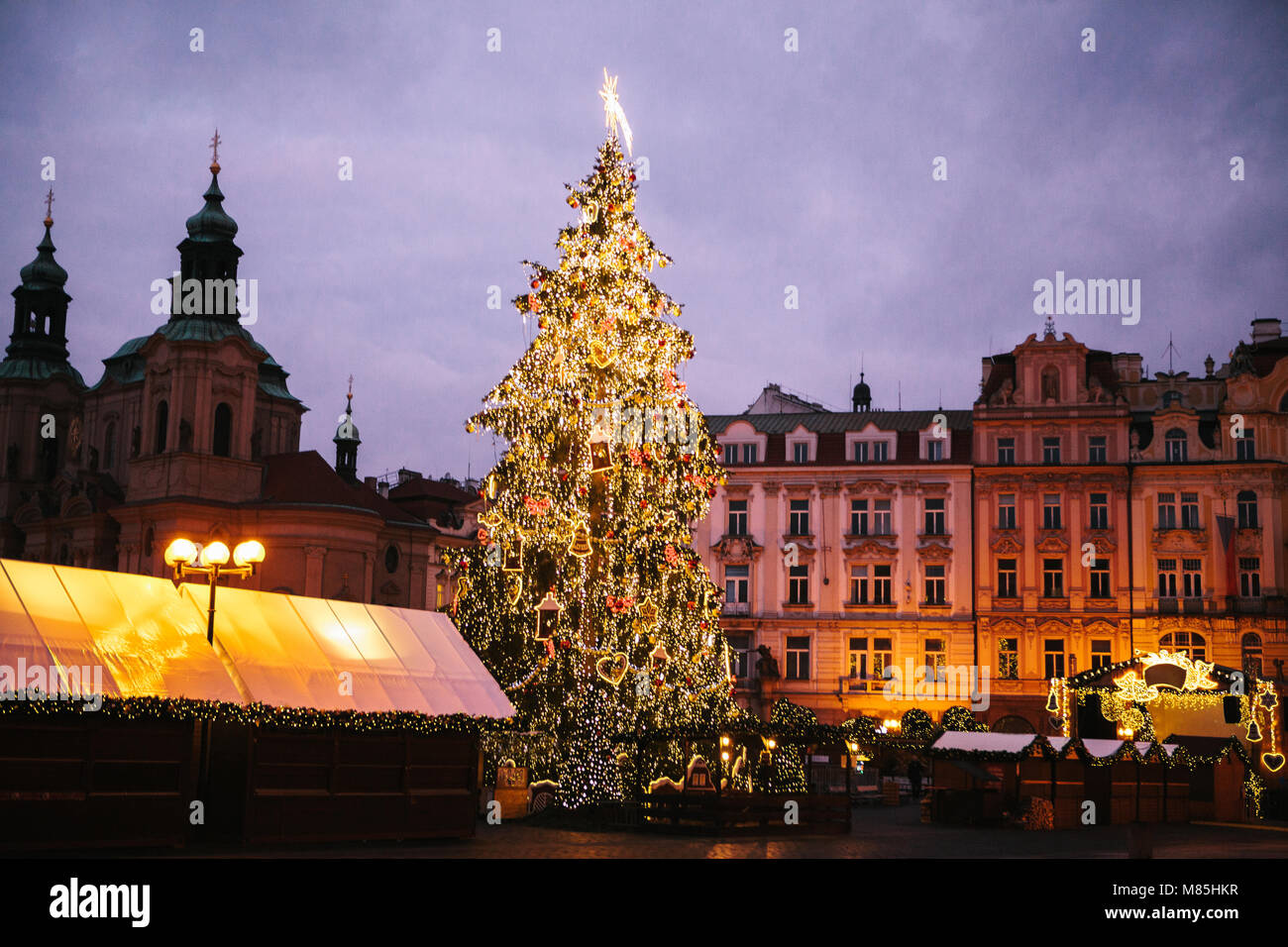 decorated christmas tree stands on the main square in prague during the new year holidays