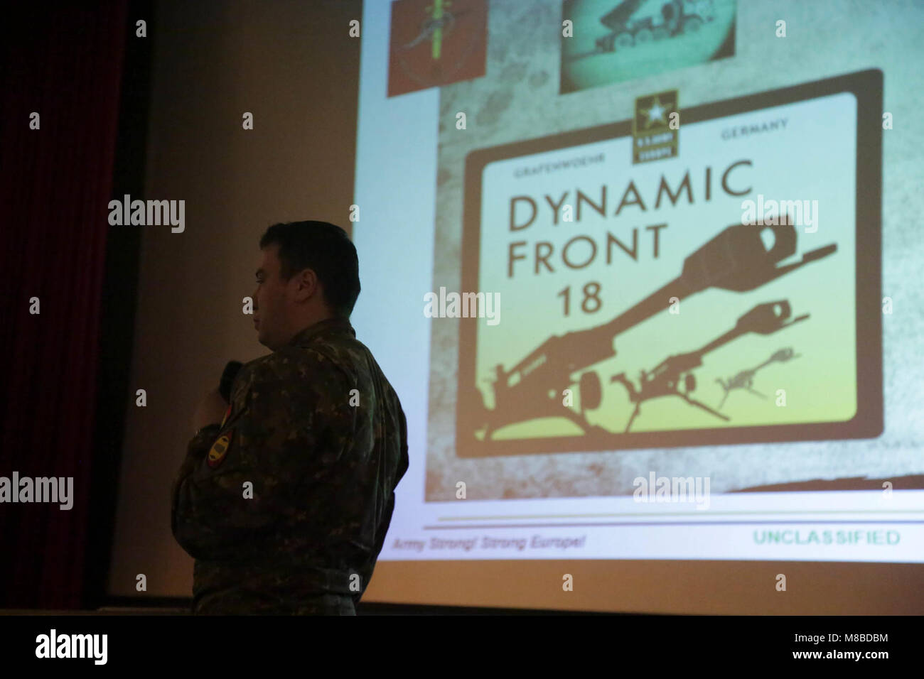 A french soldier presents a powerpoint presentation while conducting a french soldier presents a powerpoint presentation while conducting an academics brief during exercise dynamic front 18 at 7th army training commands toneelgroepblik Choice Image