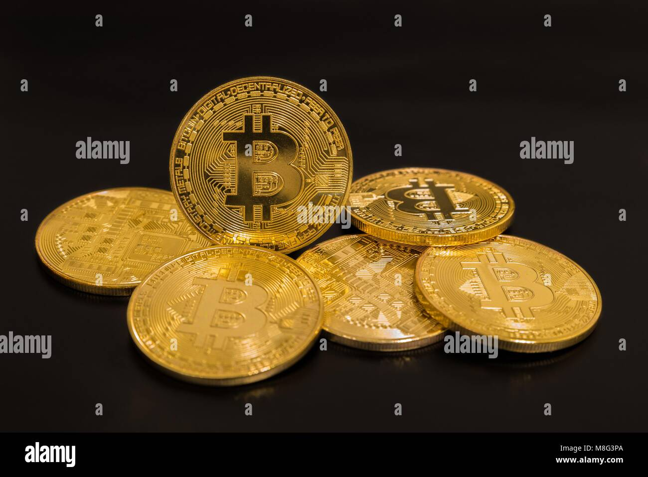 484342f3919 Gold coins bitcoin isolated on black background Stock Photo ...