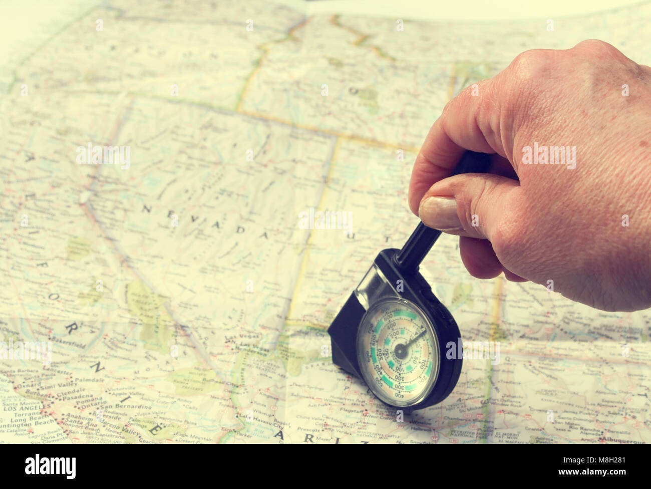 Hand with distance calculator on route map of west usa Stock Photo ...