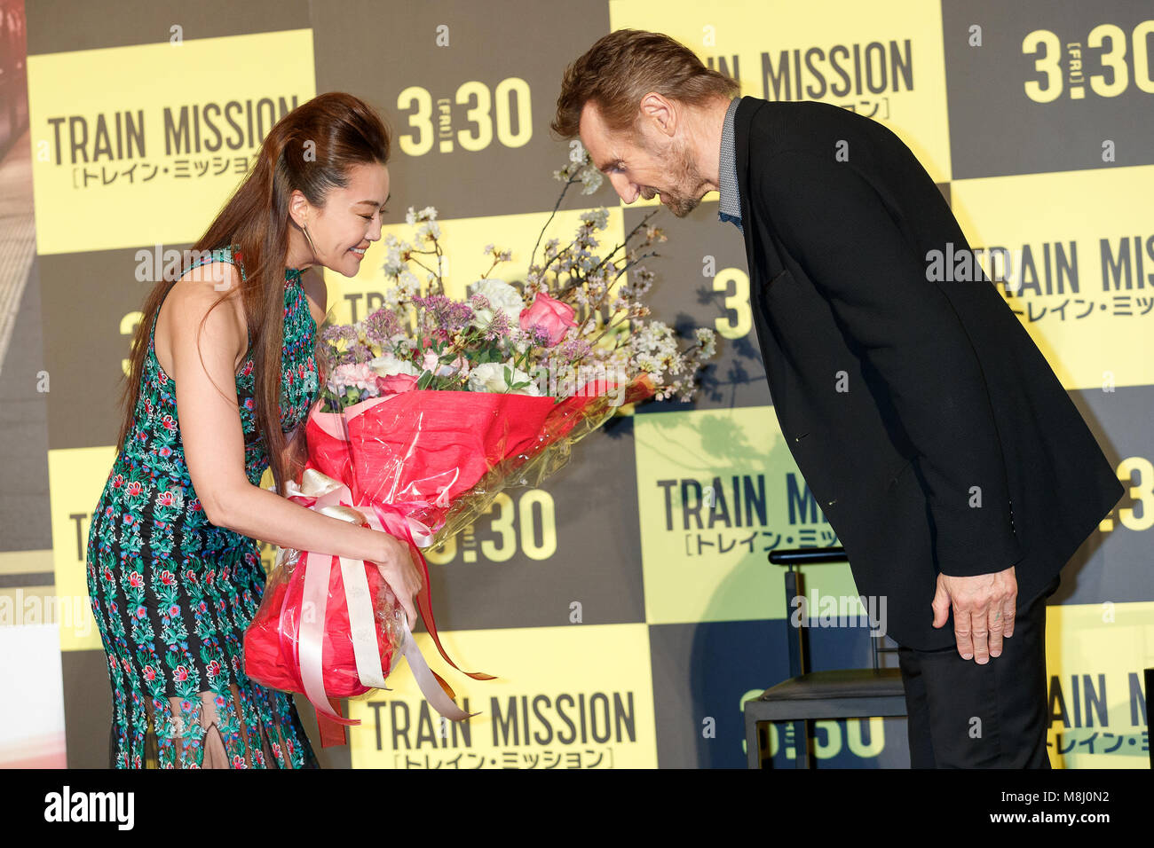 L to r japanese actress alisa mizuki and actor liam neeson greet l to r japanese actress alisa mizuki and actor liam neeson greet each other with a bow during the japan premiere for the movie the commuter on march 18 m4hsunfo