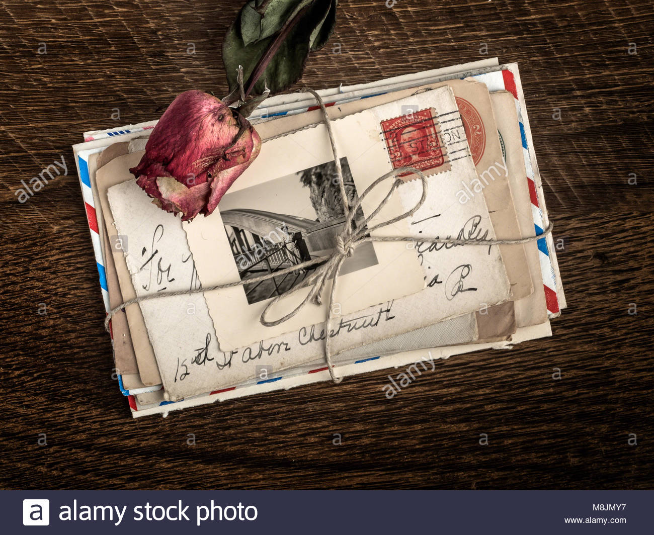 old love letters on a bunch along with a photo remember the great love long ago with withered rose