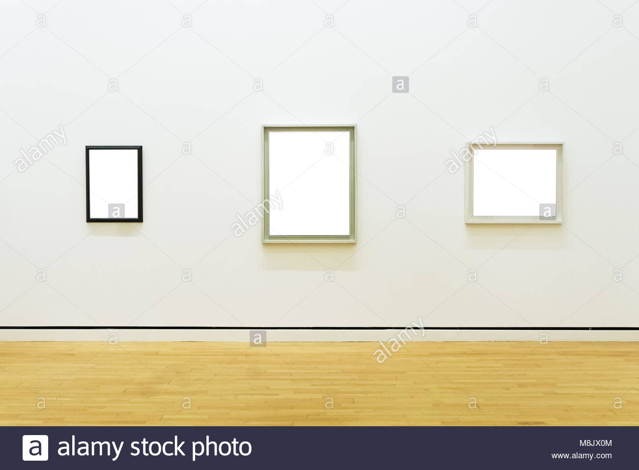 Mockup frame on floor stock photos mockup frame on floor stock three white clipped paintings with wooden carved frames hung on a clear wall stock jeuxipadfo Image collections
