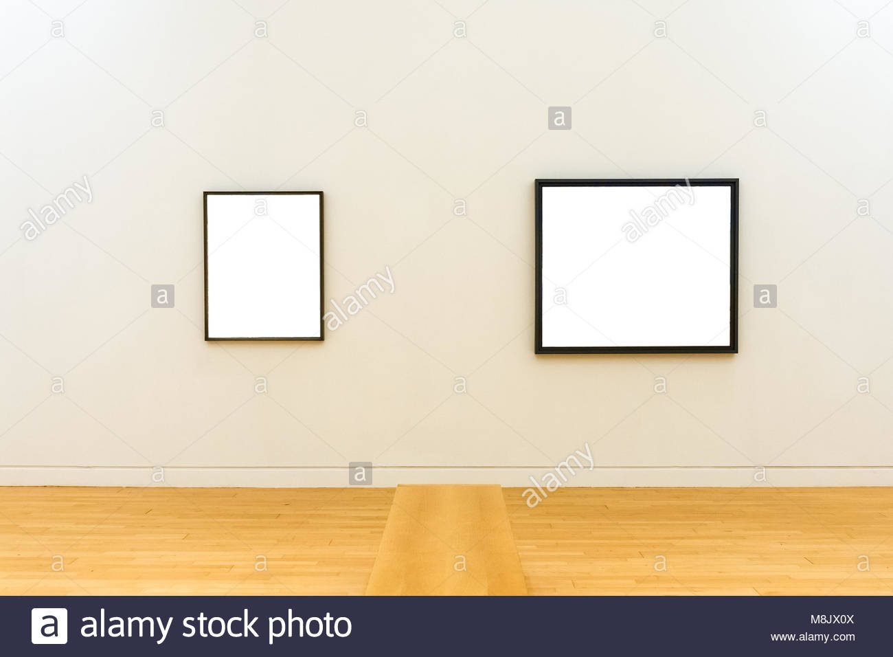 Two white clipped paintings with wooden carved frames hung on a two white clipped paintings with wooden carved frames hung on a clear wall jeuxipadfo Image collections
