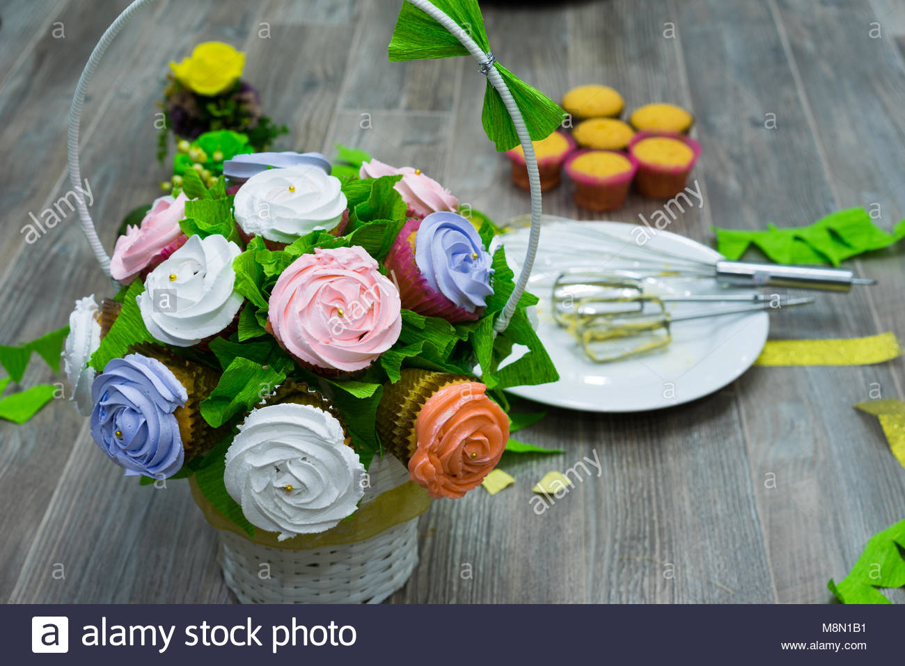Flower basket made from cupcakes and other cupcakes on the ground flower basket made from cupcakes and other cupcakes on the ground izmirmasajfo