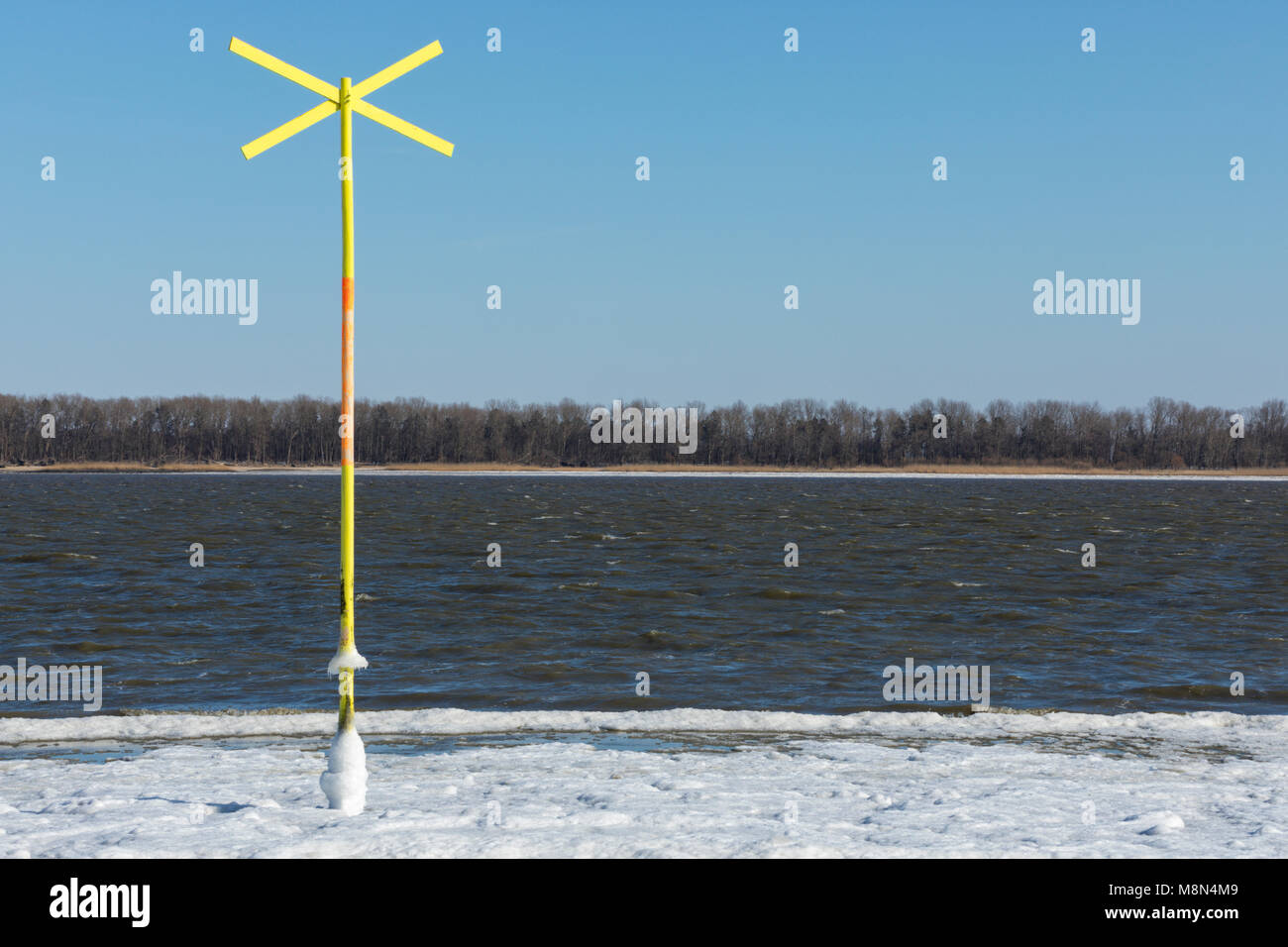 Frost warning stock photos frost warning stock images alamy vibrant yellow shallow water warning sign in partially frozen elbe river stock image buycottarizona Images