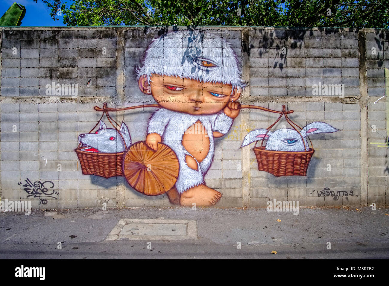 Colorful Graffiti Of A Phantasy Boy Carrying Baskets With Animals At A Wall