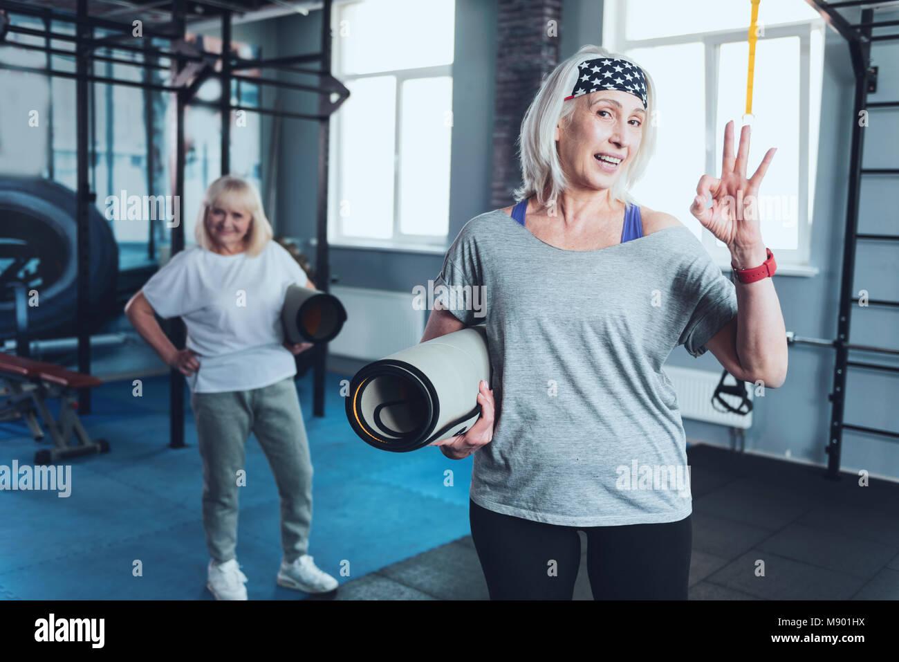 Gym sign stock photos gym sign stock images alamy positive senior woman gesturing ok sign at gym stock image buycottarizona Choice Image