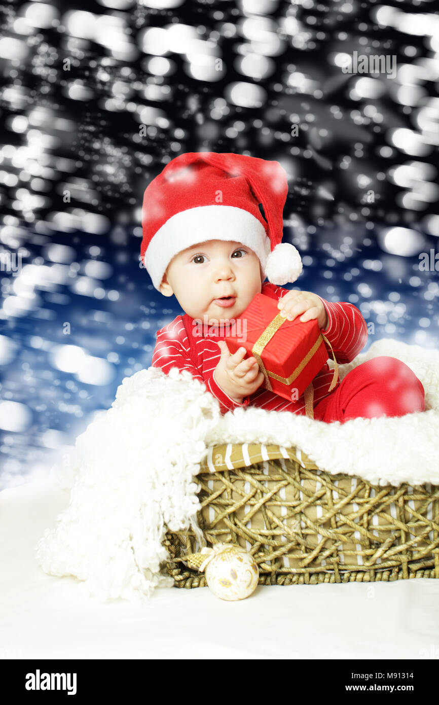cute baby with christmas gift on new year greeting card background