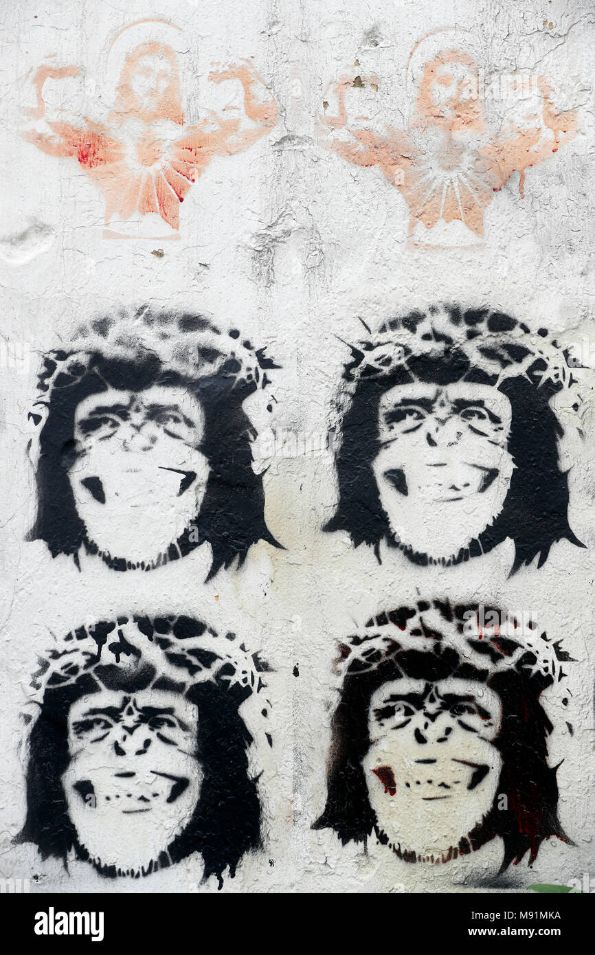 Stenciled Image Of Jesus Christ And Monkeys Wearing A Crown Thorns On Wall Caricature Hanoi Vietnam
