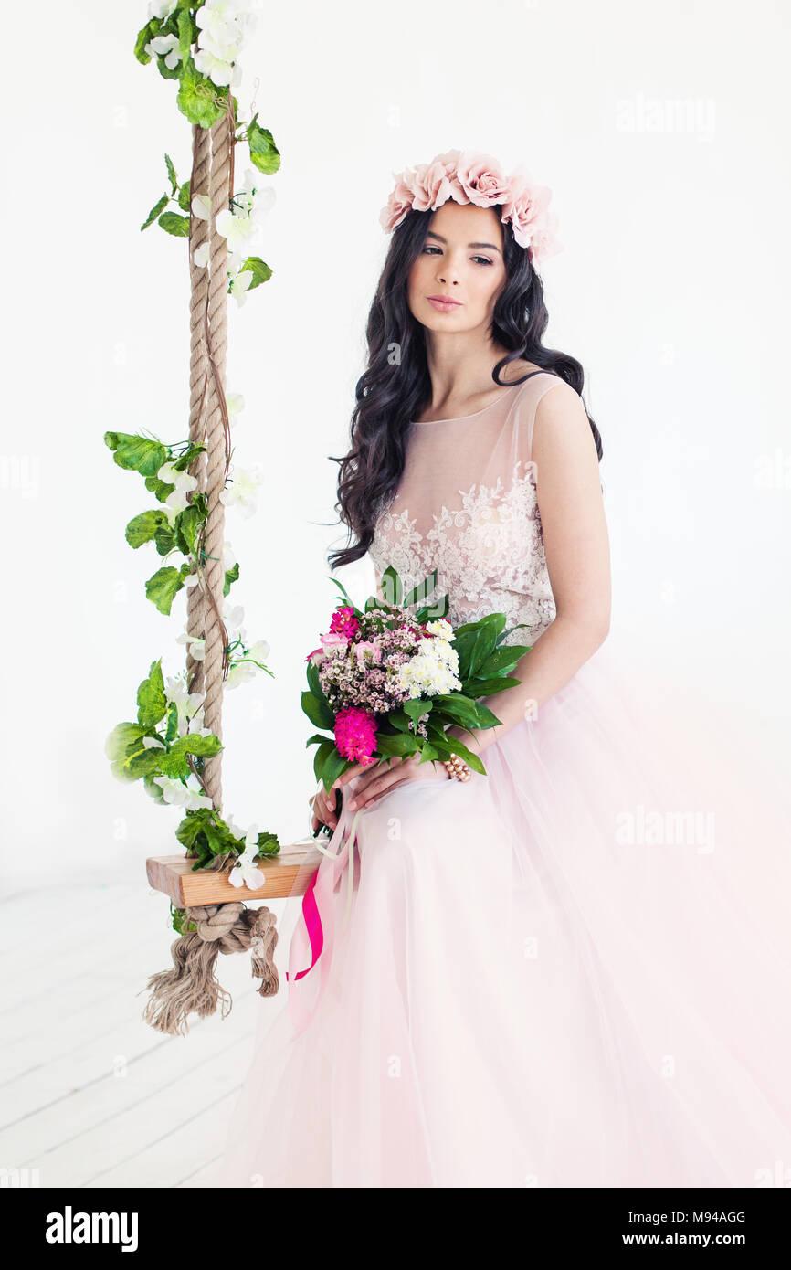 Beautiful woman fashion model wearing tulle dress cute girl with beautiful woman fashion model wearing tulle dress cute girl with flowers on white izmirmasajfo