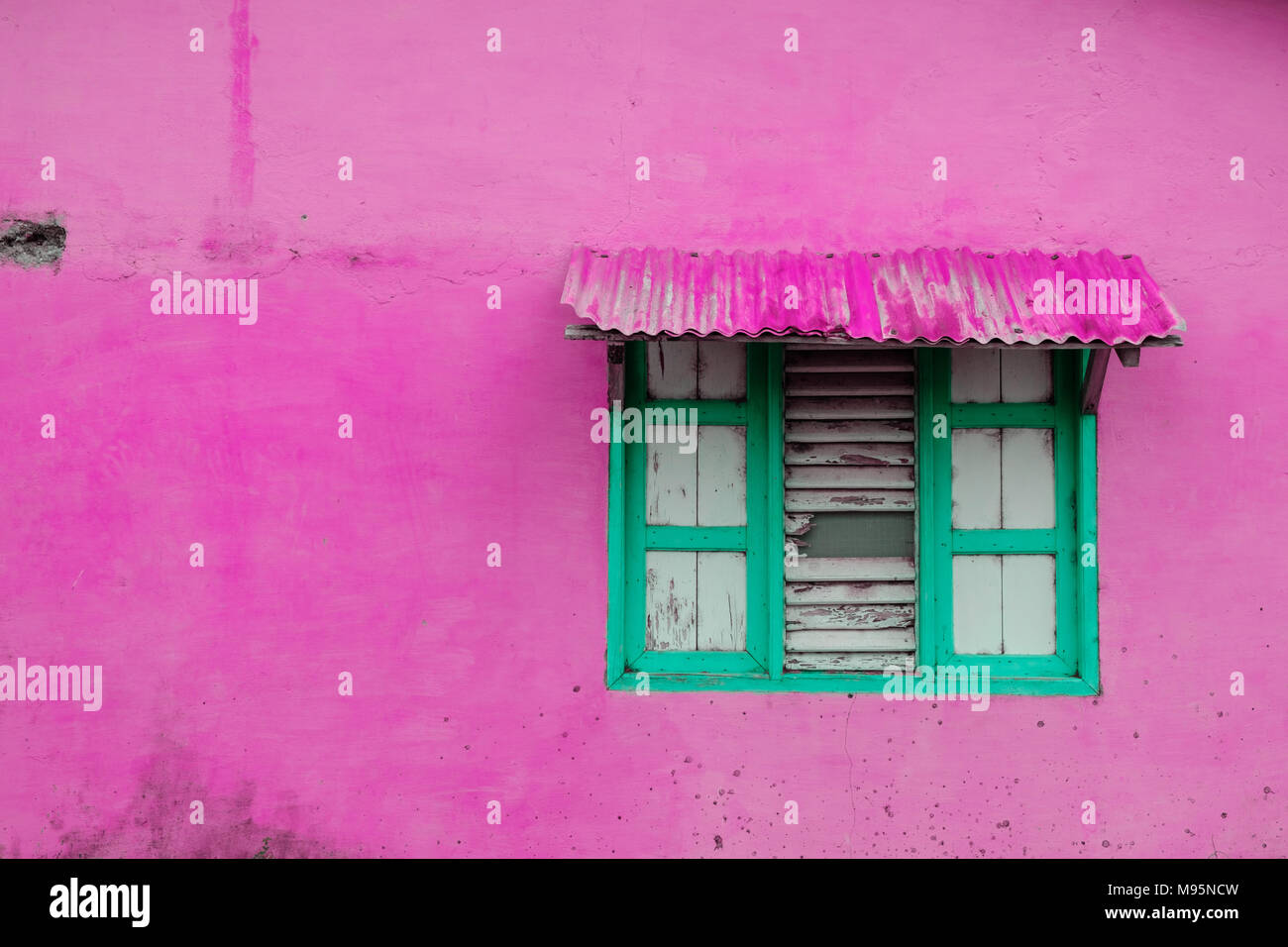 pink building exterior, vintage wall with closed window and wooden ...