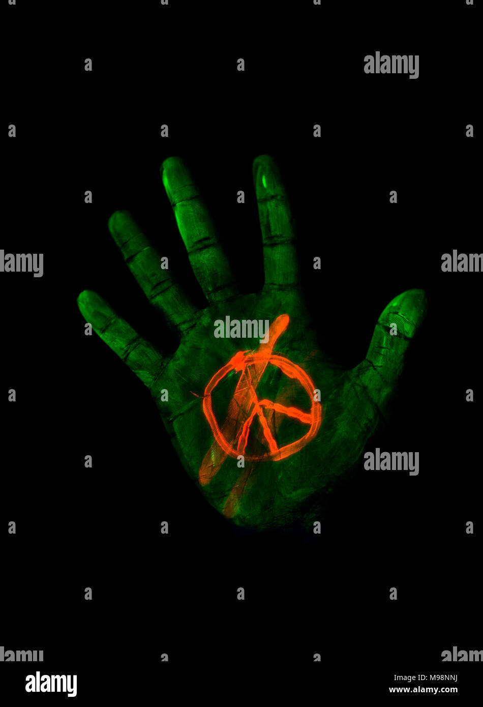 The Hand Was Painted With Glowing Colors And A Peace Symbol Stock