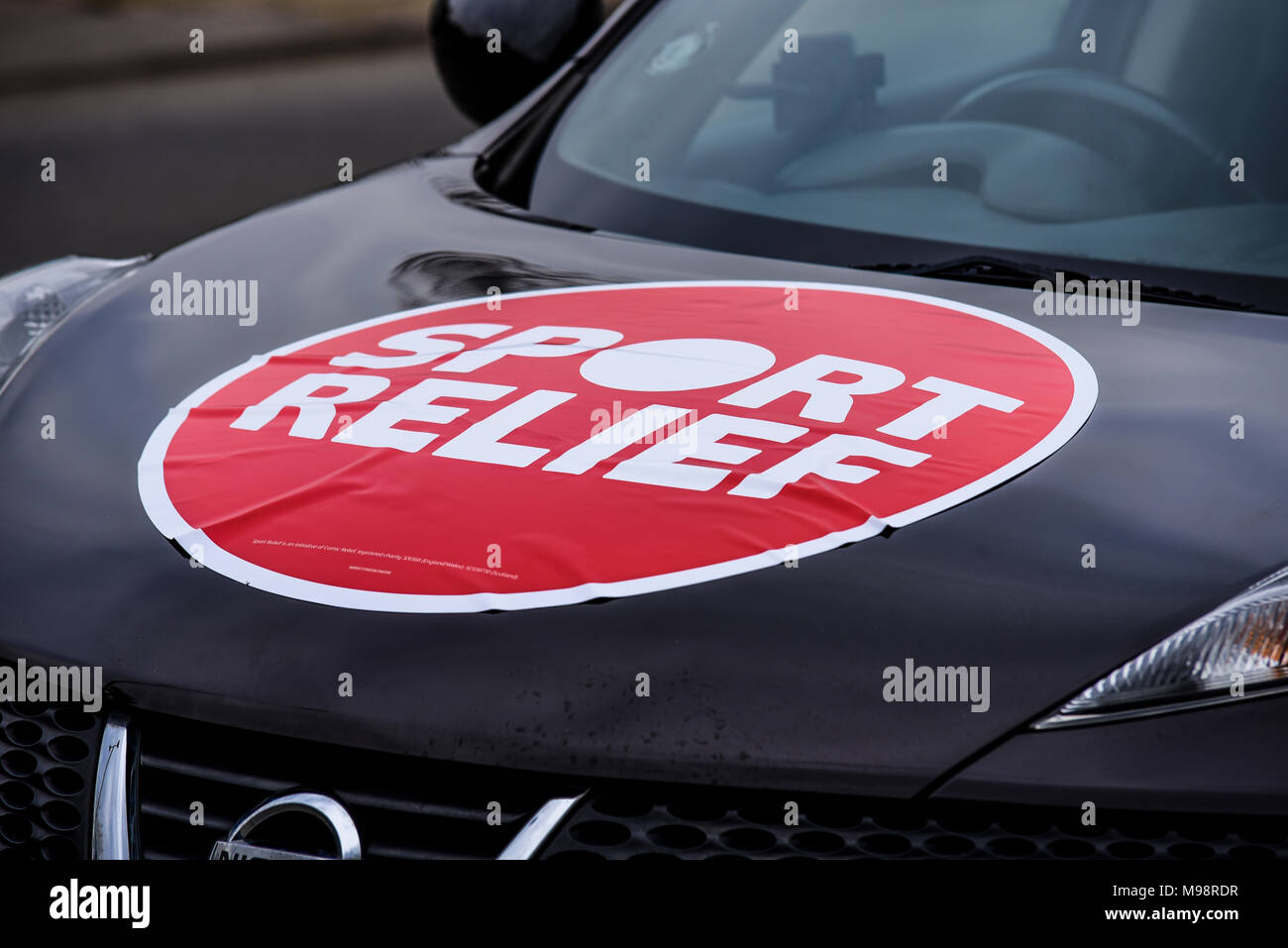 Sport Relief Logo Sticker Badly Stuck To The Bonnet Of A Nissan Juke