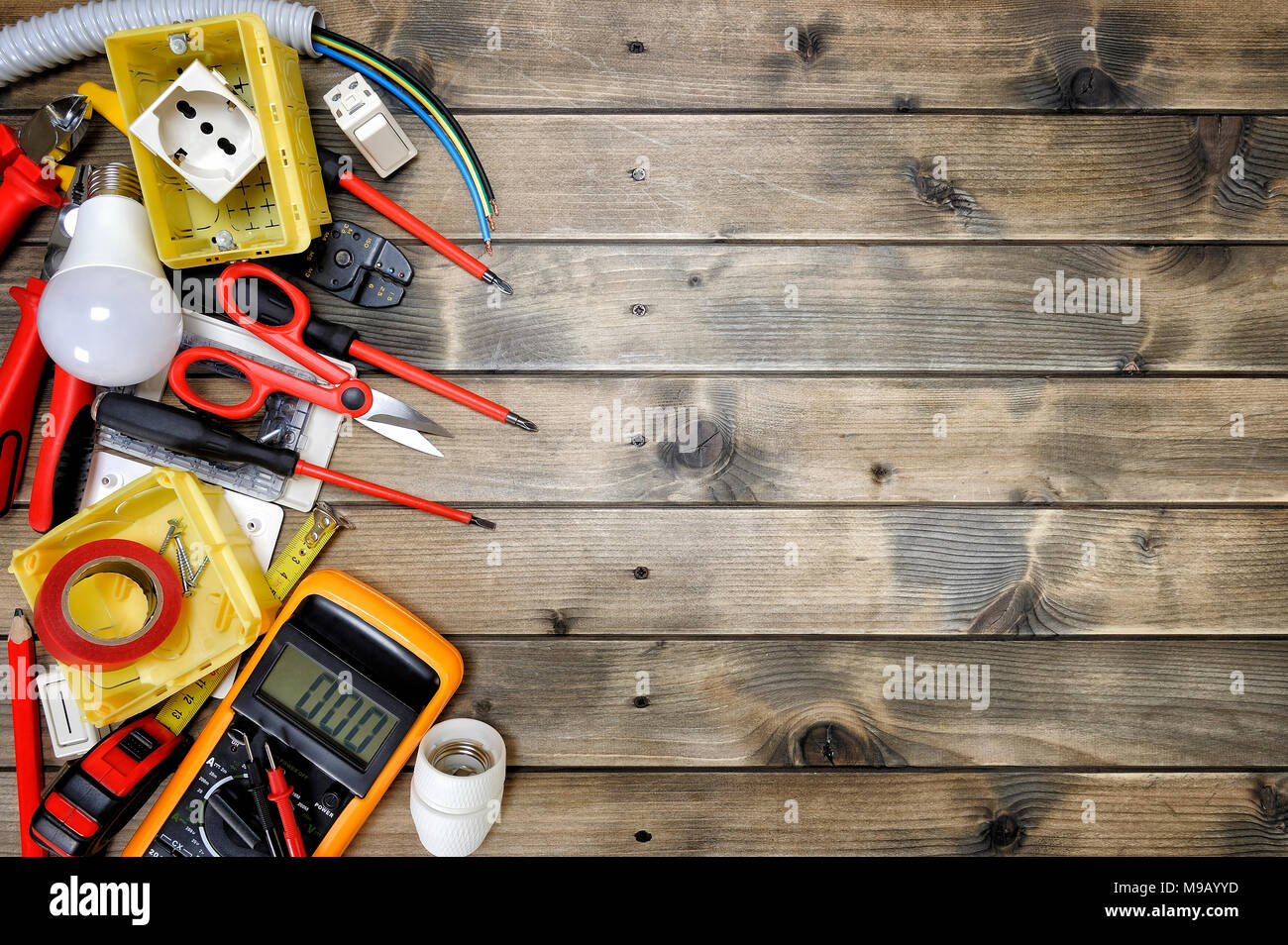 Close up of work tools and electrical equipment on an antique wooden close up of work tools and electrical equipment on an antique wooden table with space for text announcement greentooth Gallery