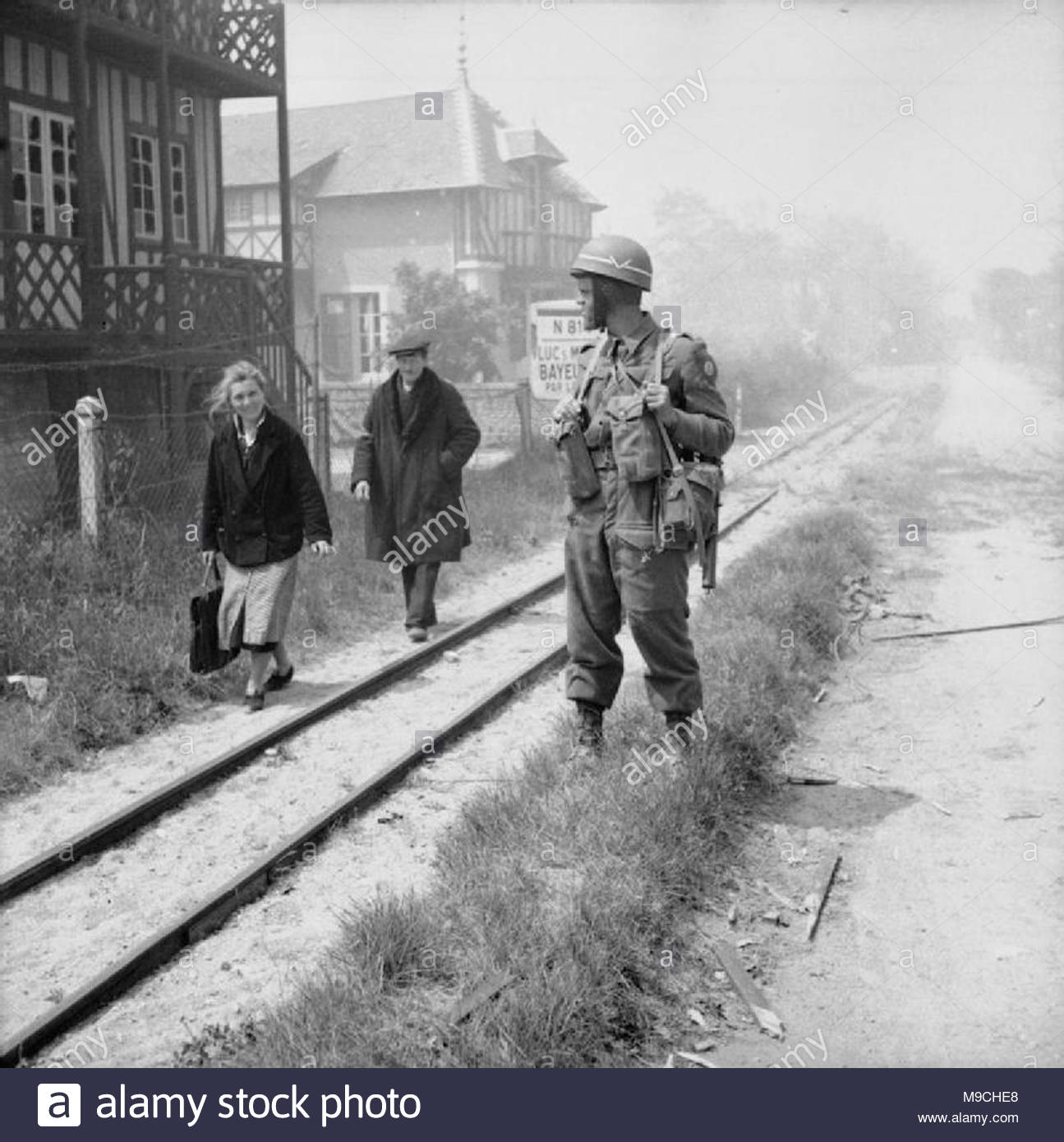The British Army In Normandy 1944 French Civilians Pa British Military Policeman By A Narrow Gauge Railway Line In La Breche