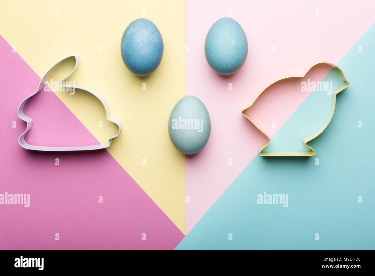 happy easter pastel coloured background easter themed cookie